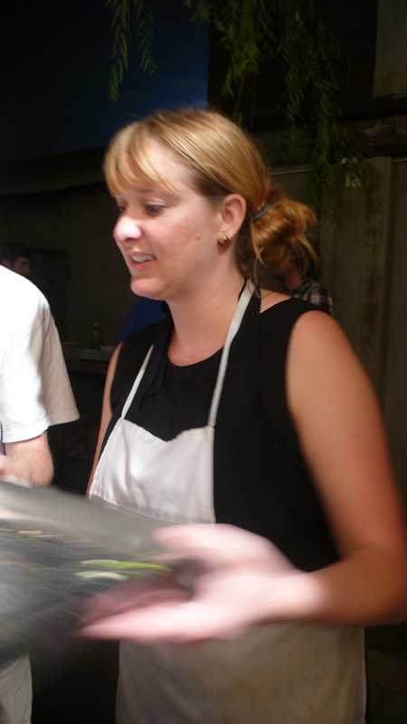Alison serving pizza