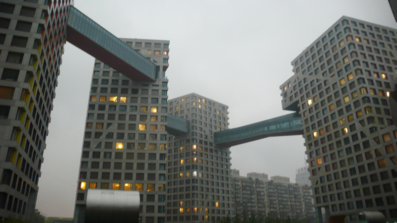 linked hybrid buildings in rain