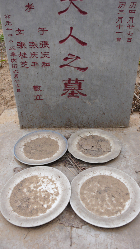 tombstone with offerings